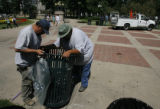 DM1760  Andy Moguez, left, and Santiago Ruiz with Denver Parks and Recreation install a new trash...