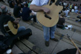 Hollis Jones (cq) of Conifer tunes his guitar before the start of an attempt at the world's...