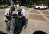 DM1761   Andy Moguez, left, and Santiago Ruiz with Denver Parks and Recreation install a new trash...