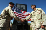 Fort Carson, Colo.-June10, 2004- Sgt. Marlon Metansingh (right) shakes the hand of 1st Lt. Mitchel...