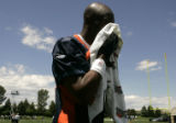 Jerry Rice wipes sweat from his brow after his first practice with the Broncos at team camp at the...