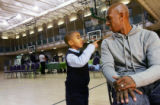 (0284) Jess Cooper, 5, talks with Denver Nugget Chauncey Billups as Billups gives away toys for...