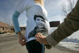 0189 Alana Kohl, 6mos. pregnant, wears a t-shirt with a picture of her brother, Mario Torabi, on...