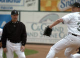 Colorado Springs Sky Sox pitching coach Bob  McClure watches starting pitcher Denny Stark warm up...