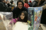 Cathy Cordova is happy that her daughter Autumn, 5  is happy,  as they shop for dolls at The...