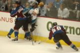 (Denver,CO,Shot On 4/28/04-- Colorado Avalanche Bob Boughner, 6, holds up San Jose Sharks Wayne...