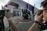 Members of the 501st stormtrooper legion pose for a picture while providing entertainment to movie...