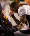 [JPM0016] Denver Broncos trainers look at Champ Bailey's elbow against the San Diego Charger in...