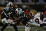 JPM329 The ball escapes Denver Broncos Eddie Royal (19) as he is defended by Carolina Panthers...