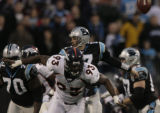 JPM356 Denver Broncos  Nic Clemons swats the ball away from Carolina Panthers Jake Delhomme in the...