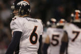 JPM498 Denver Broncos Jay Cutler glances to the bench during a break in play against the Carolina...
