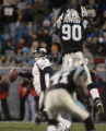 JPM507 Denver Broncos Jay Cutler (6) scrambles away from  Carolina Panthers Julius Peppers (90) in...