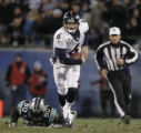 JPM512 Denver Broncos Jay Cutler escapes the rush of  Carolina Panthers Julius Peppers in the...
