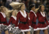 JPM580 Carolina Panthers cheerleaders wear Santa Claus-inspired costumes during a routine in the...