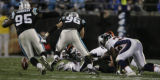 JPM619 Denver Broncos Selvin Young (35) fumbles the ball against the Carolina Panthers in the...