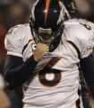 JPM676 Denver Broncos quarterback Jay Cutler (6) blows on his passing hand in the third quarter...