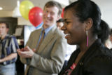 Denver Mayor John Hickenlooper applauds C'era Carroll,14 (cq) from the Manual Mentoring Program as...