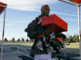 Tim Crowder carries out some boxes and equipment at Bronco Headquarters in Centennial, Colo....