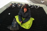 Michael Lantzy (cq) , age 55, sits at 13th Ave. and Broadway where he spent the night , sharing...