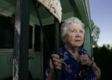Anna Thomas' stands on the porch of her home at 12th Ave. and  Kenton St. on Wednesday afternoon,...