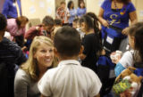 Kindergarten teacher Kelsey Thompson (cq) celebrates with her students after employees at Exempla...