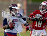 Kent Denver's Tyler Morton (left #9) is slowed down by Regis High School's Kyle Greenberg (right...