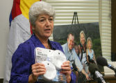 (0156) Lois Court, representative-elect of District 6, holds a carbon monoxide detector at a press...