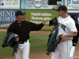 Colorado Springs Sky Sox pitching coach Bob  McClure talks with starting pitcher Denny Stark after...