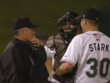 Colorado Springs Sky Sox pitching coach Bob  McClure talks with catcher Danny Ardoin and starting...