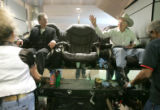 0153 Sen. Ken Salazar has his boots shined at Executive Shine while he waits for a plane to...