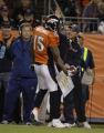JPM1522 Denver Broncos quarterbacks coach Jeremy Bates congratulates wide receiver Brandon...