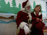 Mallorie Knox asks Santa for socks among other requests at the Gateway Academy Ken Caryl in...