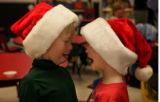Santa face off -- Max Gorzelanski, 6 and friend Aiden Kempen, 5 (l-r) had just finished giving...