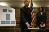 Denver District Attorney Mitch Morrisey looks after after signing a newly revised protocol during...