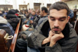 "Eric Roybal  (cq) prays during a service at the annual  ""Father Woody"" give away at the..."
