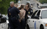 (WHEATRIDGE, Colo,; May 30, 2005) Denver Police gather evidence from a unidentified suspect after...
