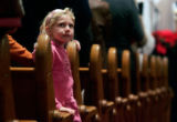 (0700) Addison Rieker, 6, looks up at Sunday service at Trinity United Methodist Church in...