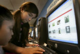 Sharon Castro, 11, cq, , a techspert, which is a young student who has learned enough about...