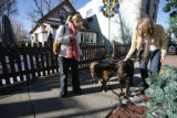 Meghan Buford of Erie and Monique Rodenburgh (l-r) of Den. stop to give Ellie and Flynn (l-r) a...