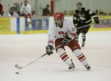 #19 Evan Lloyd (cq) of Regis Jesuit plays against Cheyenne Mountain during a high school hockey...