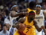 (0913)Carmelo Anthony runs into a pick as LeBron James drives to the basket in the first half of...