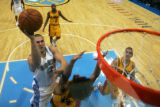 (0257)Linas Kleiza shoots over the Cavaliers defense during the first half of the Denver Nuggets...