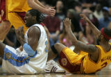 (0851)Nene protests to the ref after a collision with Mo Williams in the first half of the Denver...
