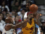 (0865)Anthony Carter defends against Mo Williams in the first half of the Denver Nuggets against...