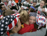 Melissa Stockwell, 25, of Minneapoolis, (face) is hugged by her best friends after finishing the...