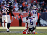 (0131) Trent Edwards s kneels on the field after being hi by Elvis Dumervil who was called for...
