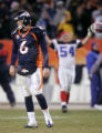 (0945) Jay Cutler walks off he field after losing to the Buffalo Bills at Invesco Field at Mile...