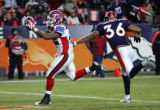 (1054) Fred Jackson runs past Josh Barrett in the fourth quarter of the Denver Broncos against the...