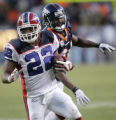 (1110) Fred Jackson eludes a tackle by Champ Bailey in the fourth quarter of the Denver Broncos...