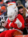 (1613) A fan gets her picture taken with Miles in the third quarter of the Denver Broncos against...